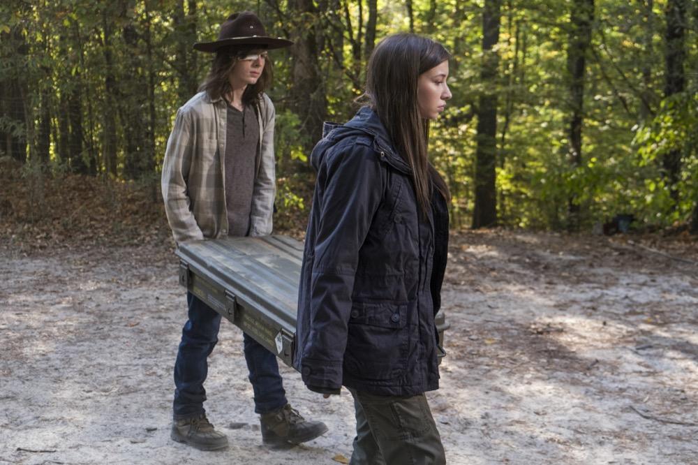 Chandler Riggs as Carl Grimes, Katelyn Nacon as Enid- The Walking Dead _ Season 7, Episode 15 - Photo Credit: Gene Page/AMC