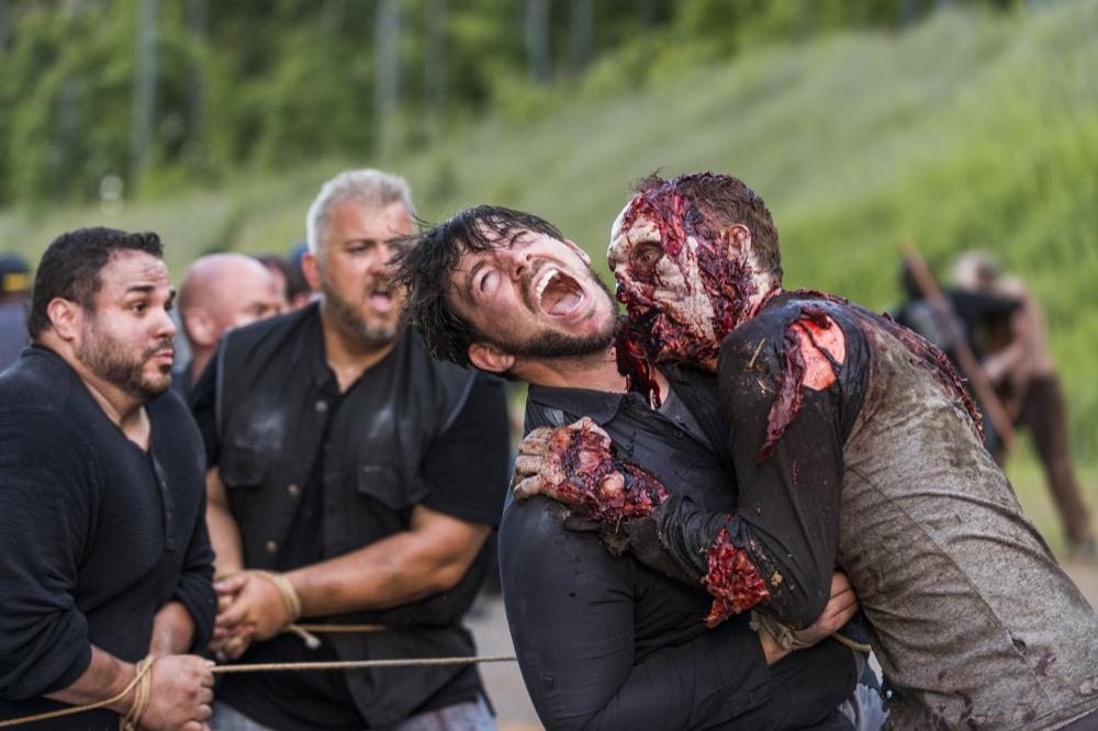 A walker attacks- The Walking Dead _ Season 8, Episode 3 - Photo Credit: Gene Page/AMC
